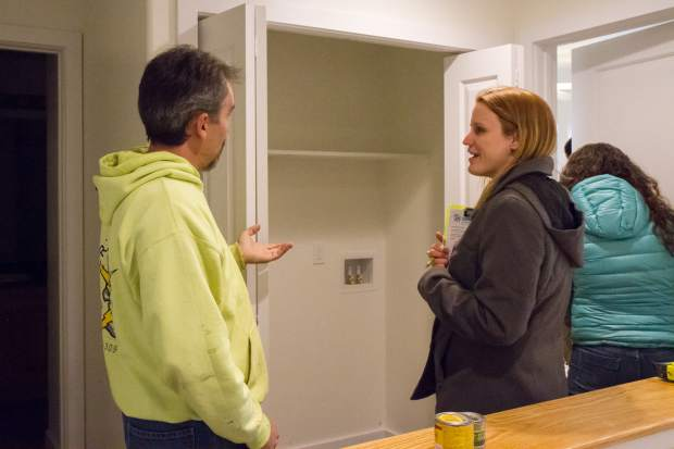 Single mom Michelle Davies, right, speaks with electrician Jim Larrechea during a tour of her new Habitat for Humanity home in Silt that she and her 14-year-old son will be occupying.