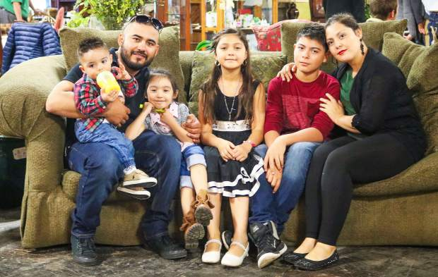 Adrian Torres, Laura Munoz and their family, including Irving, 13, Ailinne, 10, Angie, 4, and Eyden, 1.