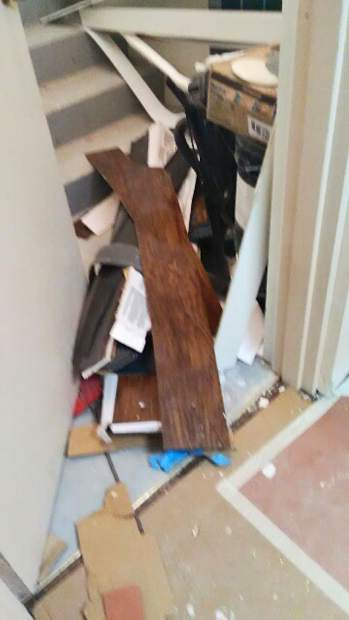 Residents of Manor I say they moved back in to find debris from the remodeling work blocking stair wells and strewn through the hallways.