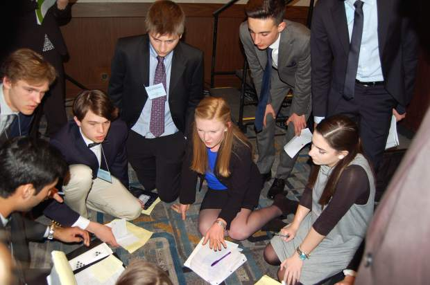 Tavia Teitler, center, a senior at Roaring Fork High School, and members from last year's RFHS Model UN club prepare for their presentations in New York City. Teitler is attending the conference for a third straight year.