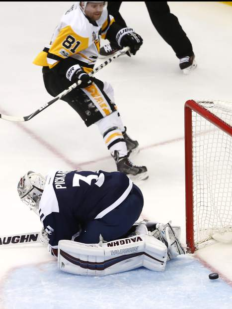 Colorado Avalanche goalie Calvin Pickard (31) lets the puck slip past for a goal by Pittsburgh Penguins right wing Phil Kessel (81) during the first period of an NHL hockey game, Thursday, Feb. 9, 2017, in Denver. (AP Photo/Jack Dempsey)
