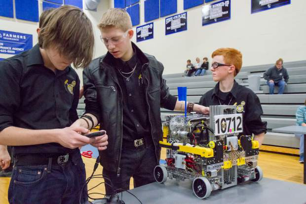 Logan Mutzbauer, Austin Ford and Tristan Sorenson from Brighton, Co prepare their robot for the FIRST Tech Challenge robotics competition at Coal Ridge High School on Saturday.