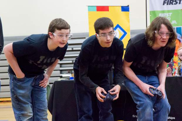 Jonathan Arroyo, Austin Davis and Zachary Barry with team Titan Technos work together during their round in the robotics competition at Coal Ridge High School on Saturday. Nine schools from around the state took part in the FIRST Tech Challenge working to make the qualifying rounds for different tournaments. The Coal Ridge Titan Technos have qualified for the state competition, which takes place later this week. For more photos and a video from the competition Saturday go to postindependent.com.
