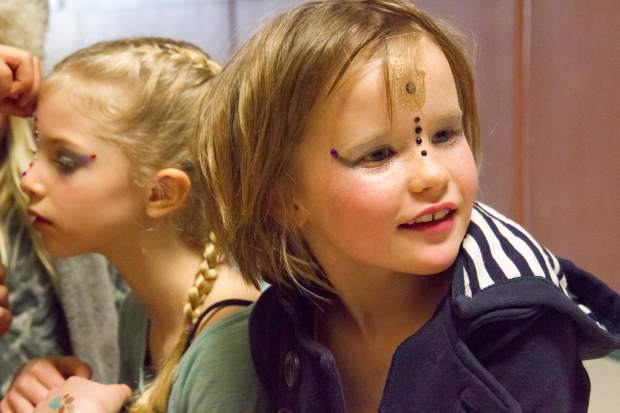 Six-year-old Genevieve Vickers gets her makeup done backstage before the show.