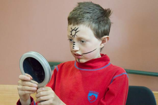 10-year-old Emmet Hood-Garcelon checks out his face painting behind stage before Cirque d'Sopris Sunday.