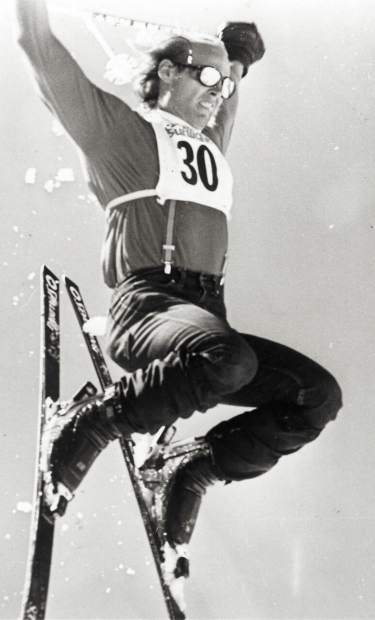An early Sunlight Ski Spree jump competition participant shows off for the crowd of revelers.