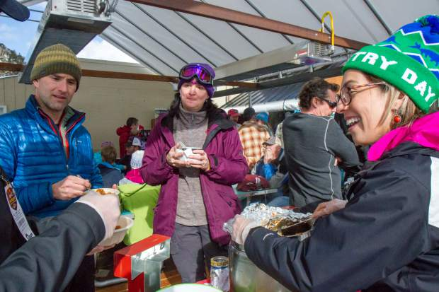 Anaclarissa Norris, right, from Aspen Country Day School tells Taste of Sunlight participants about the spicy drunken chili she made for the event. Skiers and boarders could partake in the tasting for $10 which included samples from 11 vendors from the area including Glenwood Canyon Brew Pub, Lost Cajun, Pullman, and Smoke.