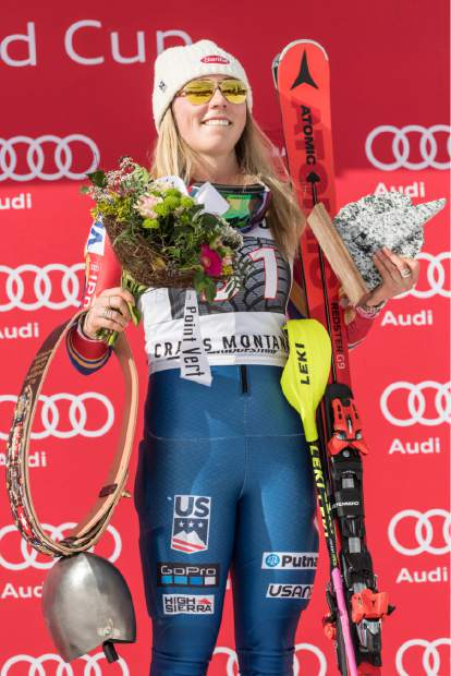 Winner Mikaela Shiffrin of the US poses on the podium after the women's alpine combined competition at the Alpine Skiing World Cup in Crans-Montana, Switzerland, Sunday, Feb. 26, 2017. (Alessandro della Valle/Keystone via AP)