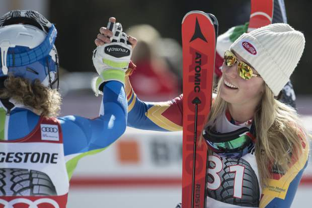 Winner Mikaela Shiffrin of the US, right, and third placed Ilka Stuhec of Slovenia shake hands in the finish area during the women's alpine combined Slalom race at the Alpine Skiing World Cup in Crans-Montana, Switzerland, Sunday, Feb. 26, 2017. (Alessandro della Valle/Keystone via AP)