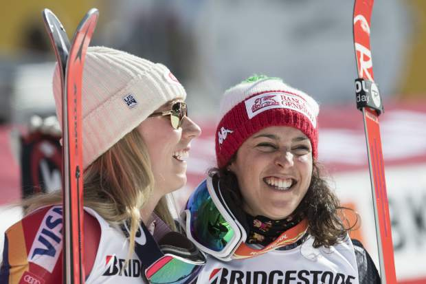 Winner Mikaela Shiffrin of the US, left, and second placed Federica Brignone of Italy react in the finish area during the women's alpine combined Slalom race at the Alpine Skiing World Cup in Crans-Montana, Switzerland, Sunday, Feb. 26, 2017. (Alessandro della Valle/Keystone via AP)