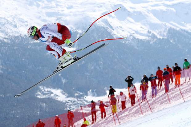 Switzerland's Beat Feuz competes during a men's downhill race, at the alpine ski World Championships in St. Moritz, Switzerland, Sunday, Feb.12, 2017. (AP Photo/Alessandro Trovati)