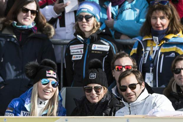 Lindsey Vonn of the United States, left, Roger Federer, Swiss tennis player, right, and his wife Mirka, center, look on during the men's downhill race at the 2017 FIS Alpine Skiing World Championships in St. Moritz, Switzerland, Sunday, Feb. 12, 2017. (Peter Schneider/Keystone via AP)