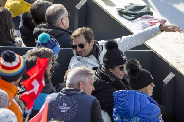 Lindsey Vonn of the United States, right, Roger Federer, Swiss tennis player, left, and his wife Mirka, center, look on during the men downhill race at the 2017 FIS Alpine Skiing World Championships in St. Moritz, Switzerland, Sunday, February 12, 2017. (/Alexandra Wey/Keystone via AP)