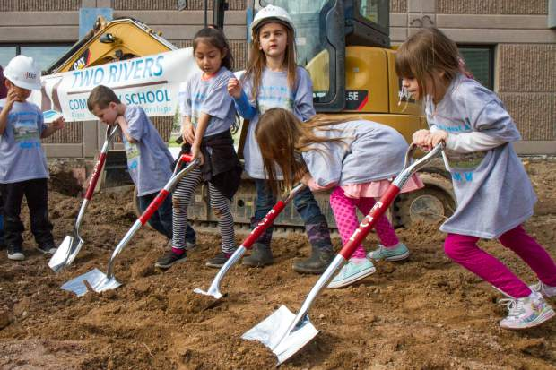 Two Rivers Community School kindergaten students take part in the groundbreaking and dedication ceremony at the school on Tuesday afternoon. The school's governing board finalized a deal in September 2016, securing $10 million in bonds to buy the former postal facility building in West Glenwood where the school is located and to complete the renovation and 8,500-square-foot addition where the new cafeteria is to be located.