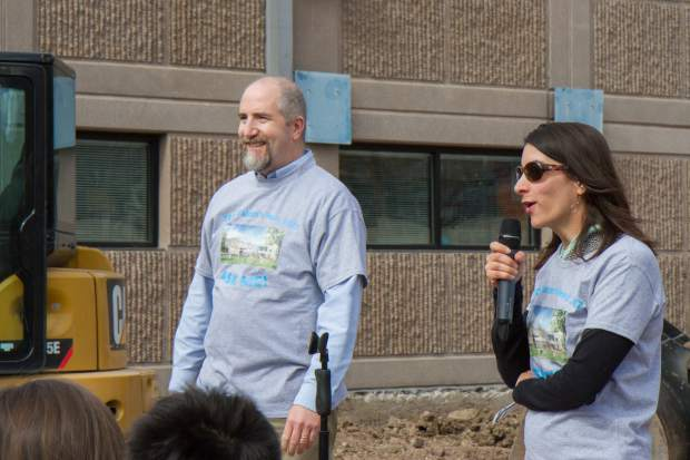 Two Rivers Community School board president Daryl Yarrow, left, and former board president Melody Massih speak to the students during the groundbreaking and dedication ceremony Tuesday afternoon.