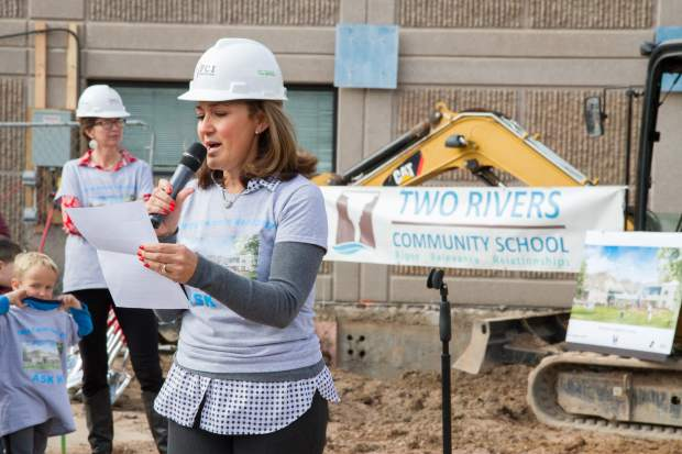 Two Rivers Community School director of business and outreach Adriana Ayala-Hire gives thanks and appreciation to the community and parents who helped make TRCS what it is.