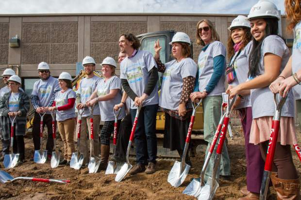 Teachers take part in the groundbreaking and dedication ceremony at the Two Rivers Community School on Tuesday afternoon.