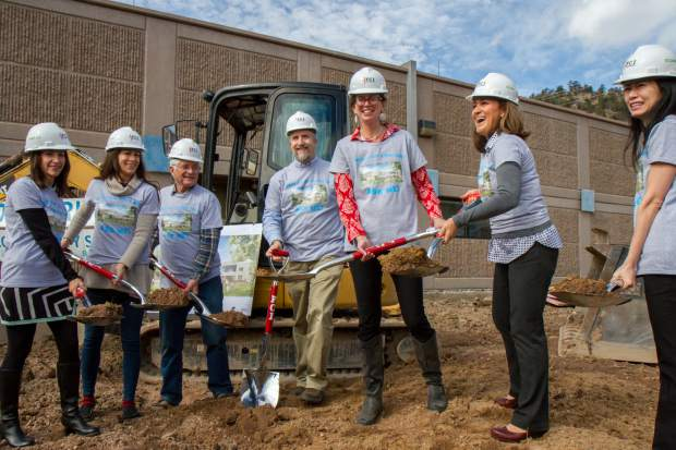 The Two Rivers Community School board of directors takes part in the groundbreaking and dedication ceremony on Tuesday afternoon. Board members and school directors gave thanks and appreciation to the community and parents who helped make the school what it is. The school's governing board finalized a deal in September 2016, securing $10 million in bonds to buy the former postal facility building in West Glenwood where the school is located and to complete the renovation and 8,500-square-foot addition where the new cafeteria is to be located.