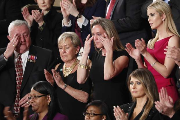 "Carryn Owens, widow of widow of Chief Special Warfare Operator William ""Ryan"" Owens, wipes her eyes on Capitol Hill in Washington, Tuesday, Feb. 28, 2017, as she was acknowledged by President Donald Trump during his address to a joint session of Congress. (AP Photo/Pablo Martinez Monsivais)"