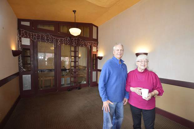 Rocky Whitworth, real estate broker with Mason Morse, left, and Emma Danciger, owner, in the western expansion of the Weant House at 689 Main St., Carbondale. This room was used as restaurant dining space with wine coolers in the rear.