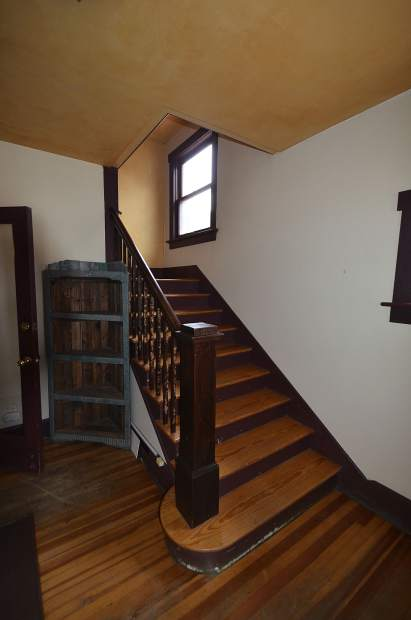 The stairway leads to four small bedrooms on the Weant House's second floor.