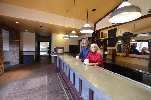 Rocky Whitworth, real estate broker with Mason Morse, left, and Emma Danciger, owner, are in the bar area of the Weant House, added to the eastern side of the building when it was first converted into a restaurant.