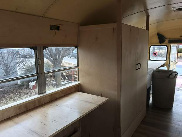 The rear portion of Rosybelle offers more permanent workspace and storage. Additional storage will be available under the bus.