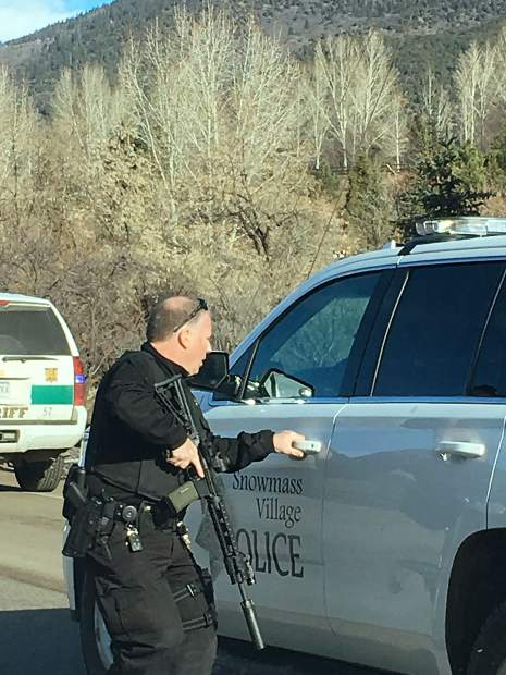 A Snowmass Village officer hightails it into his vehicle to pursue two suspects that exited an emergency exit on a public bus Tuesday. The suspects ran through Roaring Fork Club and into the hills near Basalt.