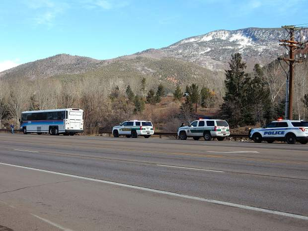 Pitkin County and Snowmass Village officers pulled over a downvalley-bound bus at about 9:22 a.m. Tuesday after they learned two suspects in a Carbondale robbery were believed to be on board.