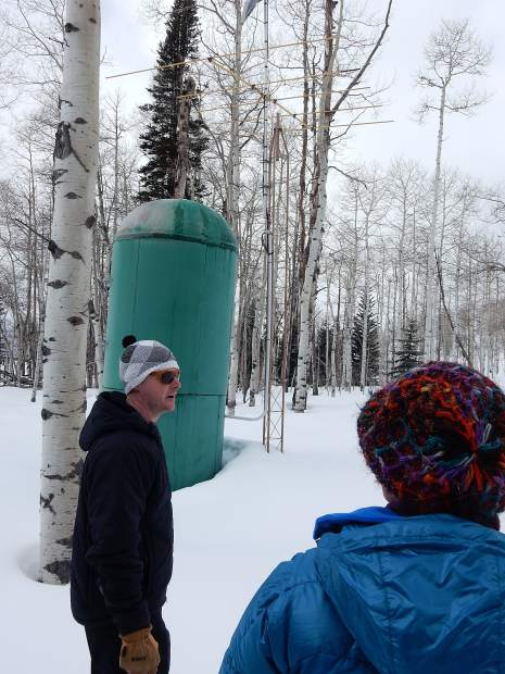 Derrick Wyle of the U.S. Natural Resources Conservaton Survey shows a class an automated Snow Telemetry station near the summit of McClure Pass. The site transmit data about the snowpack every hour.