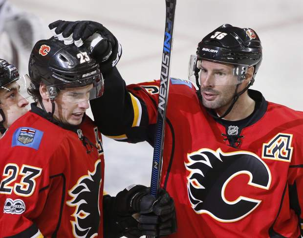 Calgary Flames' Sean Monahan, left, celebrates his goal with Troy Brouwer against the Colorado Avalanche during the first period of an NHL hockey game in Calgary, Alberta, Monday, March 27, 2017. (Larry MacDougal/The Canadian Press via AP)