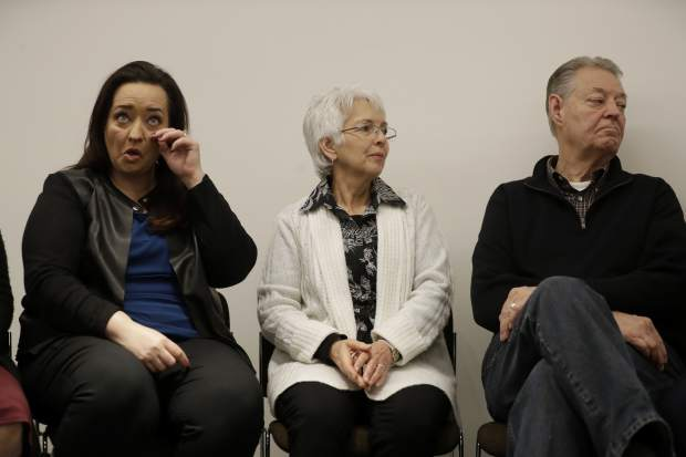 Sister Angela, left, mother Sandra, and father Dimmon of U.S. tourist Melissa Cochran, who was injured and whose husband, Kurt Cochran, was killed in Wednesday's London attack, listen during a press conference with family members at New Scotland Yard, the headquarters of the Metropolitan Police force, in London, Monday, March 27, 2017. (AP Photo/Matt Dunham)