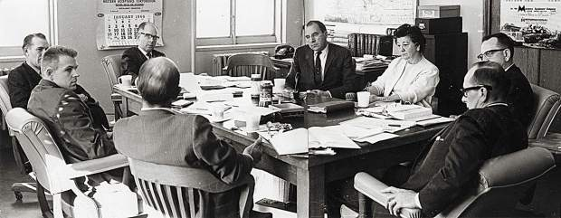 "The Colorado Mountain College Governing Board met on Jan. 7, 1966, two months after the college district was established. At the far end of the table, wearing glasses, is David Delaplane, then counterclockwise, Howard Clark (Summit County), David Barbee (Pitkin County), Dr. Leland Luchsinger (Colorado Department of Education), Pat Harvey (Lake County), Bill Stevens (Colorado Commission on Higher Education), Josephine ""Jody"" Busby (Garfield County clerk who certified the votes) and Harold Koonce (Eagle County), who was selected as first board president. The persistence of these and other pioneers to build support enabled the college to open the first two CMC campuses – the West Campus in Spring Valley and the East Campus in Leadville – on Oct. 2, 1967. Photo Colorado Mountain College archives"