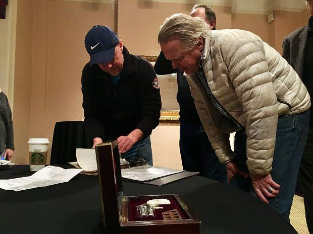 Jason Brierley, the Vancouver, British Columbia, resident who owns Doc Holliday's gun, shows it to a member of the Glenwood Springs Historical Society during a Wednesday meeting at the Hotel Colorado.
