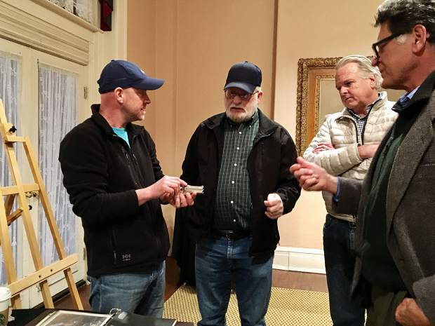 Jason Brierley holds Doc Holliday's derringer while speaking to Glenwood Springs Historical Society members about the gun's provenance.