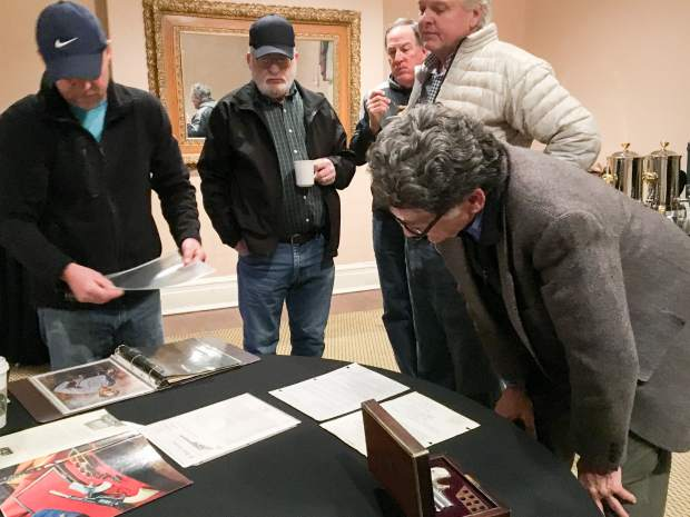 Glenwood Springs Historical Society Executive Director Bill Kight, right, looks at paperwork that establishes the authenticity of Doc Holliday's derringer gun.