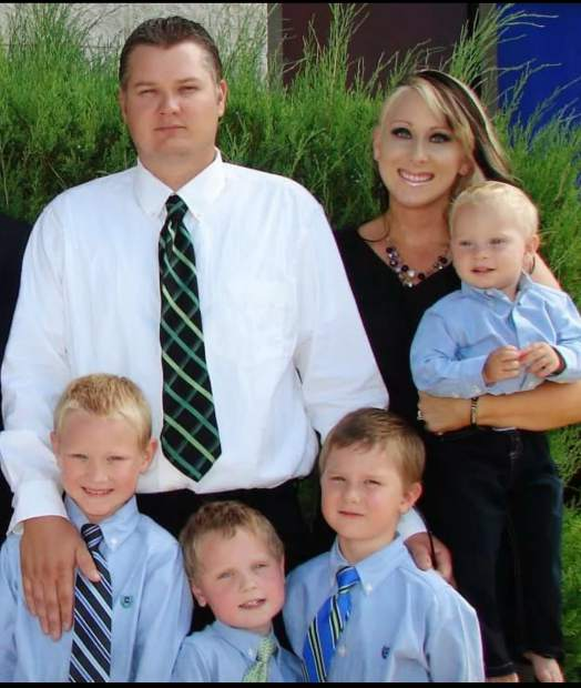 The Richardson family, Taylor, the father; Gina, the mother; and their sons.