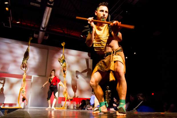 During Green is the New Black fashion extravaganza, Rising Crane and Sporis Soarers collaborated on the warrior scene. Performers used swords and silks to illustrate the strength of the warrior woman archetype.