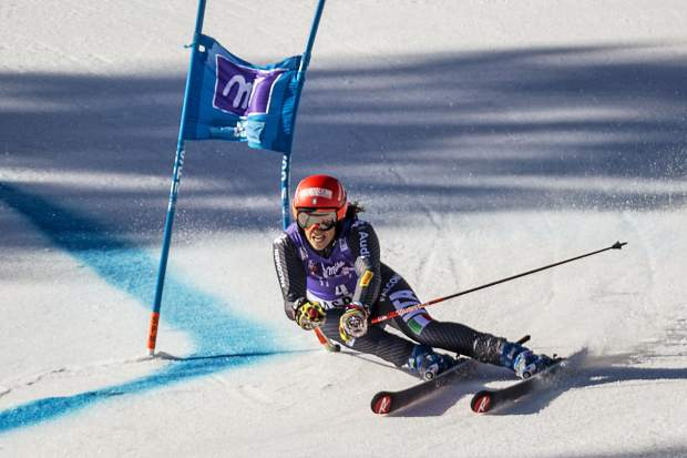 First place finisher Federica Bringnone powers down the giant slalom course Sunday at World Cup Finals.