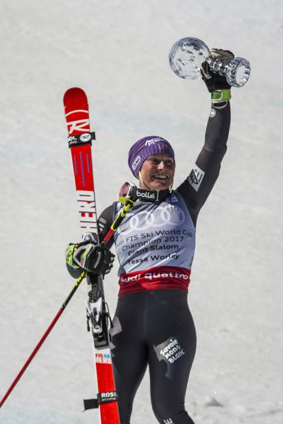 Overal women's giant slalom champion Tessa Worley holds her globe in the air after her second race Sunday at the World Cup Finals.