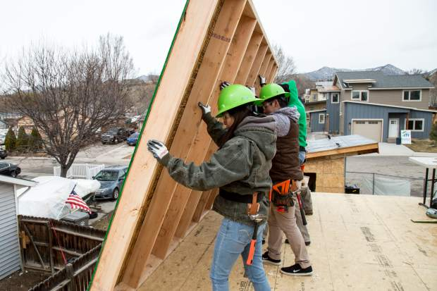 After building one of the first walls on the second floor of the duplexes, Trio students work together to lift the wall into place. Trio student volunteers get the opportunity to learn real life skills with the help of the Roaring Fork Habitat for Humanity.