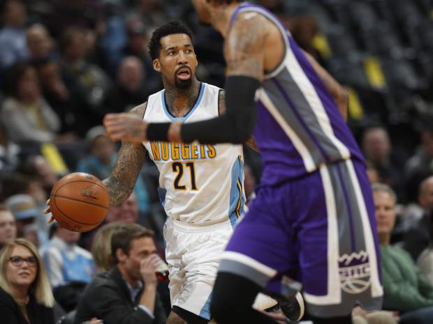Denver Nuggets forward Wilson Chandler, back, brings the ball up the court as Sacramento Kings center Willie Cauley-Stein drops back to defend in the first half of an NBA basketball game Monday, March 6, 2017, in Denver. (AP Photo/David Zalubowski)