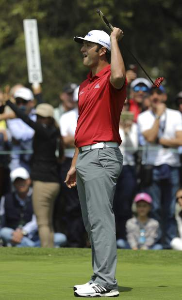 Spain's Jon Rahm watches his shot from the 4th hole green during the final round of the Mexico Championship at Chapultepec Golf Club in Mexico City, Sunday, March 5, 2017. All but one of the world's top 50 golfers are contesting the World Golf Championship PGA event, which this year relocated to Mexico City from the Trump National Doral Resort in Florida. (AP Photo/Christian Palma)