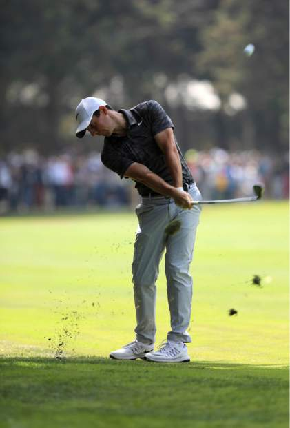Rory McIlroy, of Northern Ireland, hits the ball on the 4th hole during the final round of the Mexico Championship at Chapultepec Golf Club in Mexico City, Sunday, March 5, 2017. All but one of the world's top 50 golfers are contesting the World Golf Championship PGA event, which this year relocated to Mexico City from the Trump National Doral Resort in Florida. (AP Photo/Christian Palma)