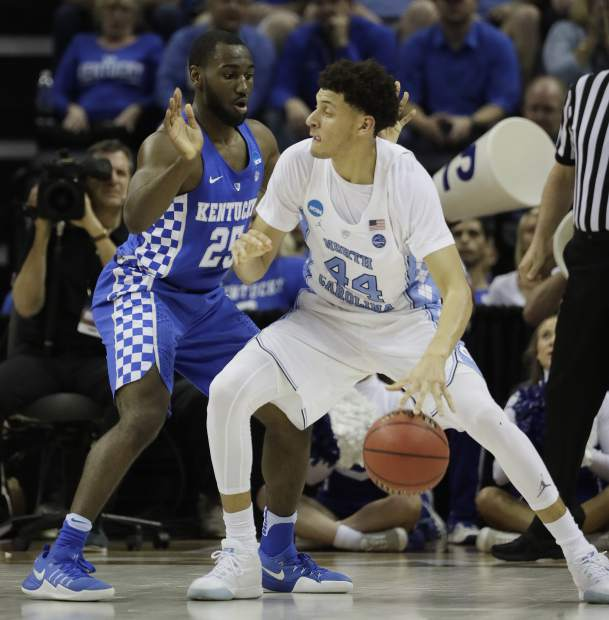 North Carolina forward Justin Jackson (44) drives on Kentucky guard Dominique Hawkins (25) in the first half of the South Regional final game in the NCAA college basketball tournament Sunday, March 26, 2017, in Memphis, Tenn. (AP Photo/Mark Humphrey)