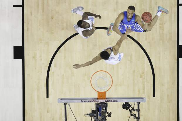 Kentucky guard Isaiah Briscoe (13) shoots against North Carolina guard Joel Berry II (2) in the first half of the South Regional final game in the NCAA college basketball tournament Sunday, March 26, 2017, in Memphis, Tenn. (AP Photo/Mark Humphrey)