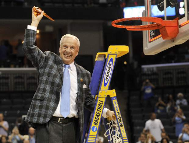 North Carolina head coach Roy Williams cuts down the net after North Carolina beat Kentucky 75-73 in the South Regional final game in the NCAA college basketball tournament Sunday, March 26, 2017, in Memphis, Tenn. (AP Photo/Brandon Dill)