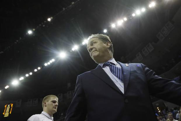 Kentucky head coach John Calipari walks off the court after the first half of the South Regional final game in the NCAA college basketball tournament against North Carolina, Sunday, March 26, 2017, in Memphis, Tenn. (AP Photo/Mark Humphrey)