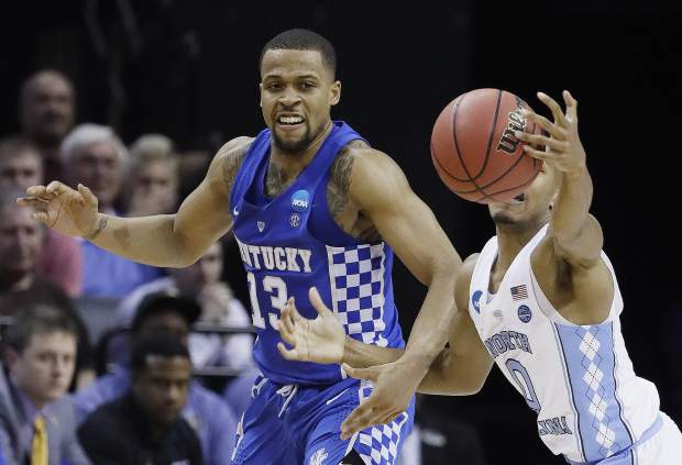 North Carolina guard Nate Britt (0) grabs a loose ball ahead of Kentucky guard Isaiah Briscoe (13) in the first half of the South Regional final game in the NCAA college basketball tournament Sunday, March 26, 2017, in Memphis, Tenn. (AP Photo/Mark Humphrey)