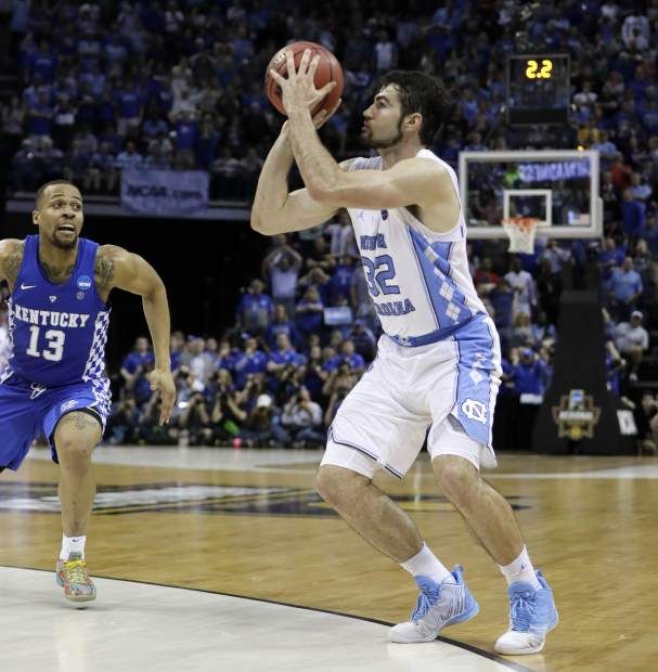 North Carolina forward Luke Maye (32) shoots the winning basket as Kentucky guard Isaiah Briscoe (13) defends in the second half of the South Regional final game in the NCAA college basketball tournament Sunday, March 26, 2017, in Memphis, Tenn. The basket gave North Carolina a 75-73 win. (AP Photo/Mark Humphrey)